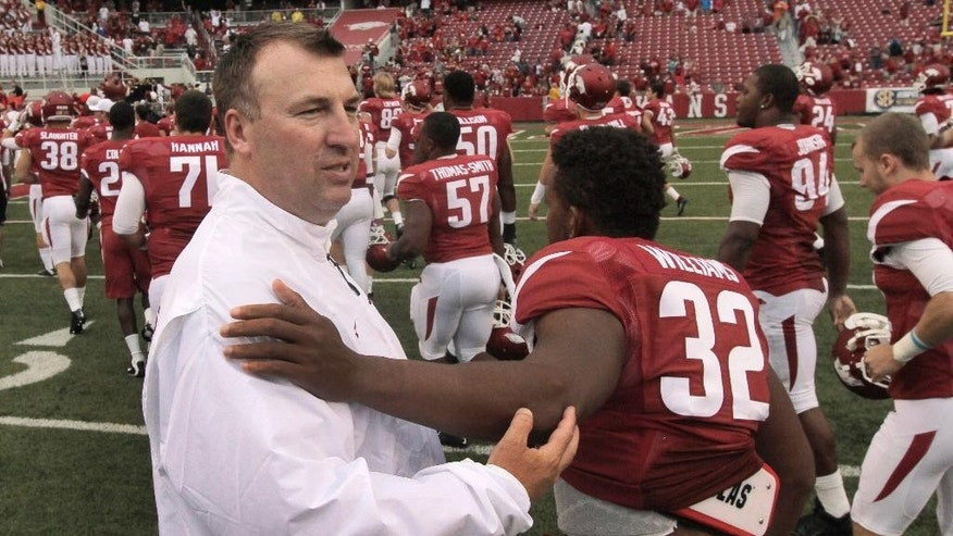 Arkansas coach Bret Bielema greets Arkansas running back Jonathan Williams (32) after an NCAA college football game in Fayetteville, Ark., Saturday, Sept. 6, 2014. Arkansas defeated Nicholls 73-7. (AP Photo/Danny Johnston)