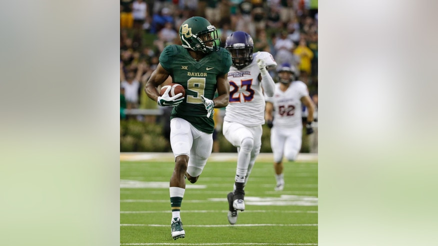 Baylor wide receiver KD Cannon (9) sprints to the end zone after a reception for a touchdown as Northwestern State cornerback Fred Thomas (23) gives chase in the first half of an NCAA college football game, Saturday, Sept. 6, 2014, in Waco, Texas. (AP Photo/Tony Gutierrez)