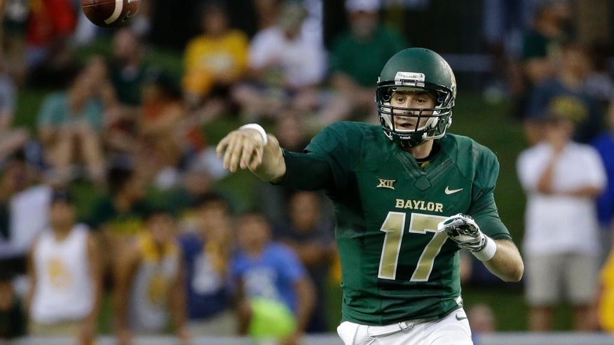 Baylor's Seth Russell throws a pass in the first half of an NCAA college football game against Northwestern State, Saturday, Sept. 6, 2014, in Waco, Texas. (AP Photo/Tony Gutierrez)
