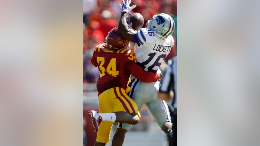 Kansas State wide receiver Tyler Lockett (16) hauls in a pass over Iowa State defensive back Nigel Tribune (34) during the second half of an NCAA college football game Saturday, Sept. 6, 2014, in Ames, Iowa. Kansas State won 32-28. (AP Photo/Justin Hayworth)