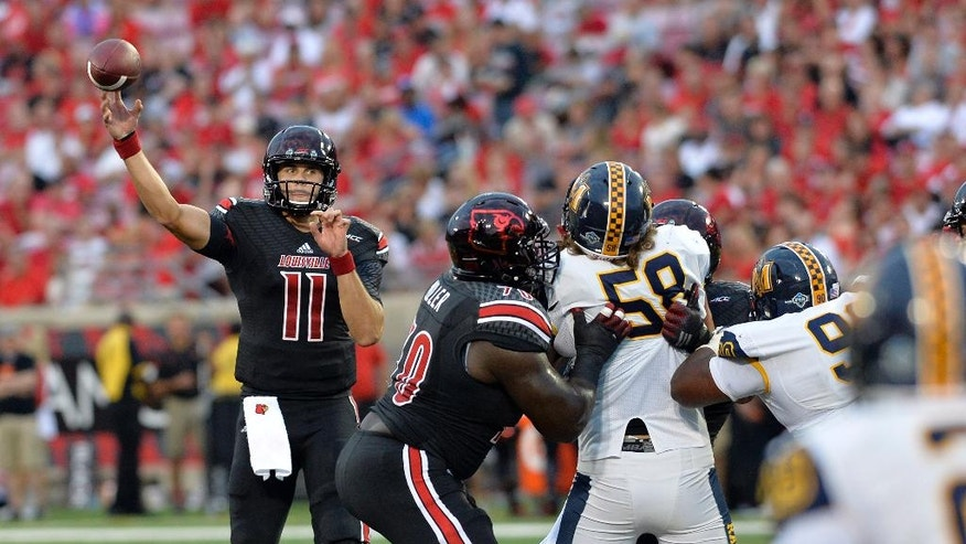 Louisville quarterback Will Gardner, left, throws a pass during the second quarter of their NCAA college football game Saturday, Sept. 6, 2014 at Papa John's Cardinal Stadium in Louisville, Ky. (AP Photo/Timothy D. Easley)