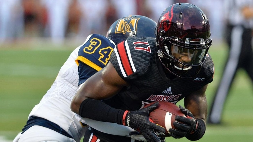 Louisville's James Quick, right, is wrapped up by Murray State's D'Montre Wade during the second quarter of their NCAA college football game Saturday, Sept. 6, 2014 at Papa John's Cardinal Stadium in Louisville, Ky. (AP Photo/Timothy D. Easley)