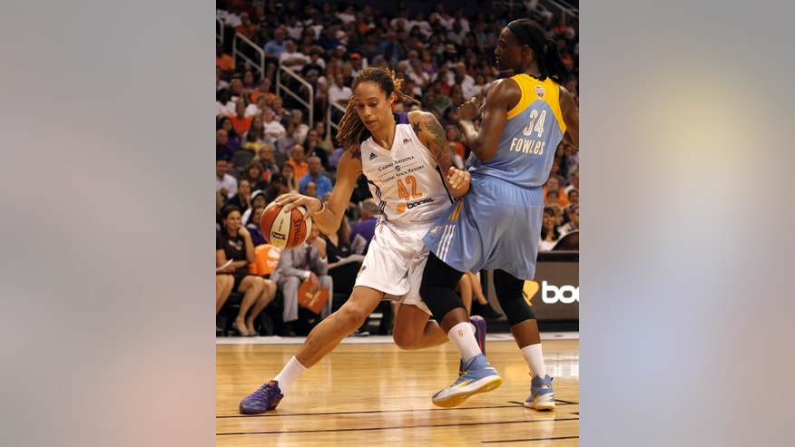 Phoenix Mercury center Brittney Griner (42) drives on Chicago Sky center Sylvia Fowles (34) in the first half of Game 1 of the WNBA basketball finals, Sunday, Sept. 7, 2014, in Phoenix. (AP Photo/Rick Scuteri)