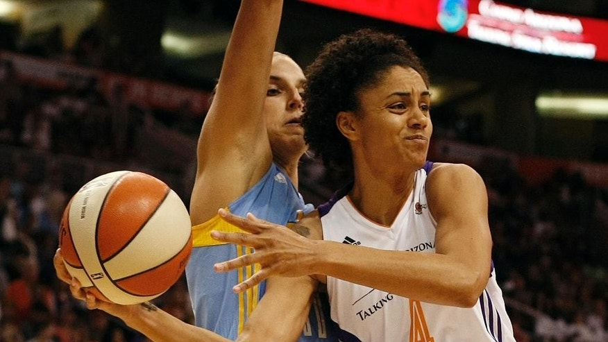 Phoenix Mercury forward Candice Dupree (4) looks to pass on Chicago Sky forward Elena Delle Donne (11) in the first half of Game 1 of the WNBA basketball finals, Sunday, Sept. 7, 2014, in Phoenix. (AP Photo/Rick Scuteri)
