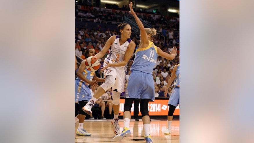 Phoenix Mercury guard Diana Taurasi (3) passes around Chicago Sky guard/forward Elena Delle Donne (11) in the first half of Game 1 of the WNBA basketball finals, Sunday, Sept. 7, 2014, in Phoenix. (AP Photo/Rick Scuteri)