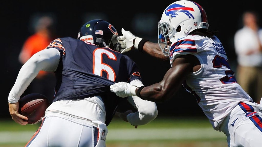 Buffalo Bills defensive back Nickell Robey (37) puts pressure on Chicago Bears quarterback Jay Cutler (6) during the second half of an NFL football game Sunday, Sept. 7, 2014, in Chicago. (AP Photo/Charles Rex Arbogast)