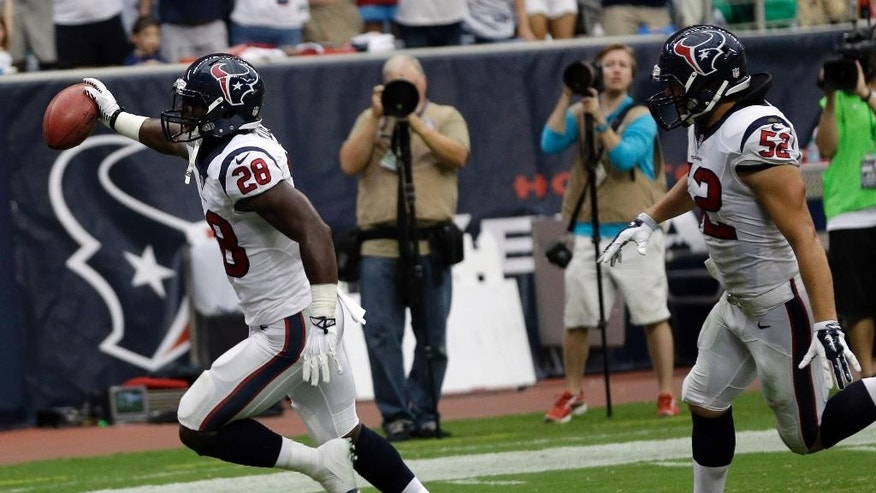 Houston Texans' Alfred Blue (28) scores against the Washington Redskins on a blocked punt during the second quarter of an NFL football game Sunday, Sept. 7, 2014, in Houston. (AP Photo/David J. Phillip)