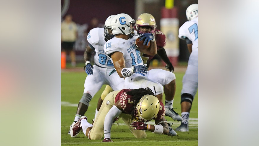 The Citadel's Vinney Miller is tackled by Florida State's Ronald Darby in the first quarter of an NCAA college football game Saturday, Sept. 6, 2014, in Tallahassee, Fla. (AP Photo/Steve Cannon)