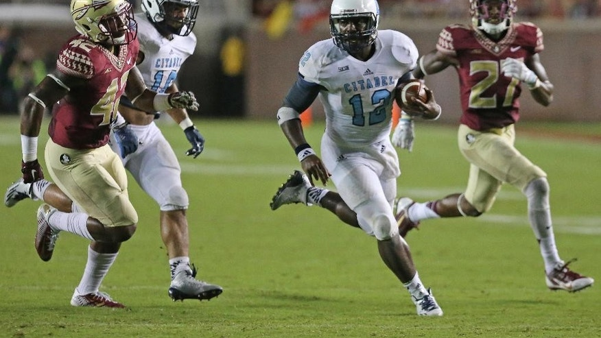 The Citadel's Aaron Miller is chased down by Florida State's Marquez White, right, and Lamarcus Brutus in the fourth quarter of an NCAA college football game on Saturday, Sept. 6, 2014 in Tallahassee, Fla. Florida State won 37-12. (AP Photo/Steve Cannon)
