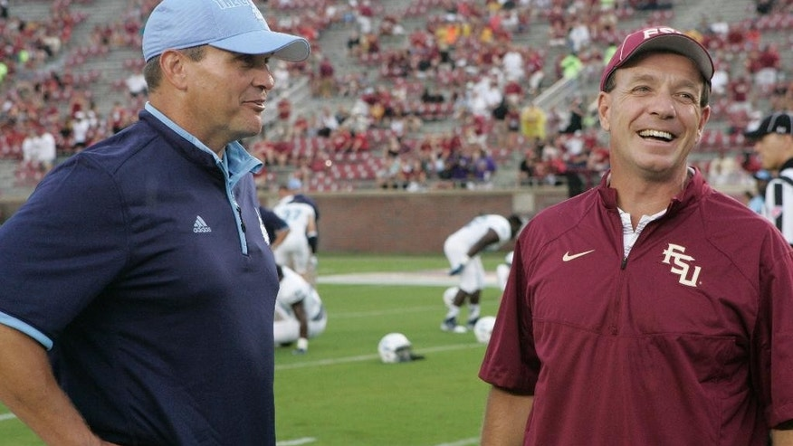 The Citadel coach Mike Houston talks with Florida State coach Jimbo Fisher, right, before an NCAA college football game Saturday, Sept. 6, 2014, in Tallahassee, Fla. Florida State won 37-12. (AP Photo/Steve Cannon)
