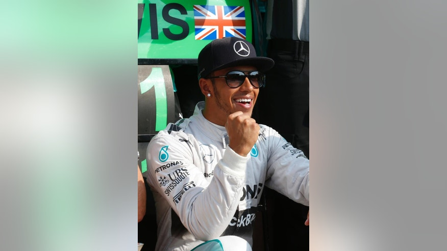Britain's Lewis Hamilton celebrates after winning during the Italian Formula One Grand Prix at the Monza racetrack, in Monza, Italy , Sunday, Sept. 7 , 2014. (AP Photo/Luca Bruno)