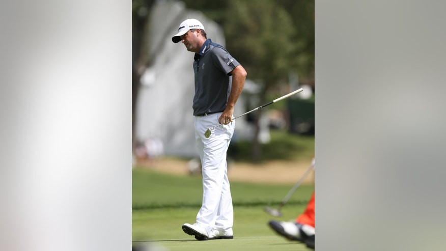 Ryan Palmer reacts after missing a putt for a birdie on the second hole in the final round of the BMW Championship golf tournament in Cherry Hills Village, Colo., on Sunday, Sept. 7, 2014. (AP Photo/David Zalubowski)