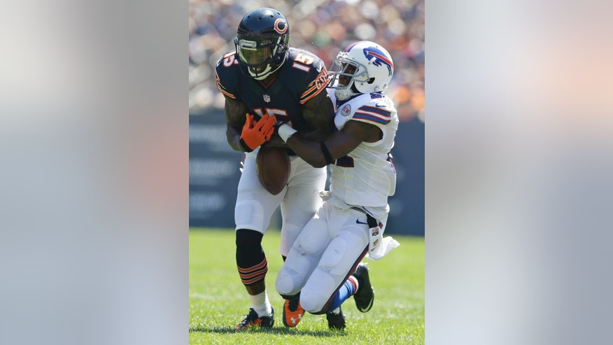 Chicago Bears wide receiver Brandon Marshall (15) fumbles as he is tackled by Buffalo Bills cornerback Leodis McKelvin (21) during the first half of an NFL football game Sunday, Sept. 7, 2014, in Chicago. (AP Photo/Nam Y. Huh)