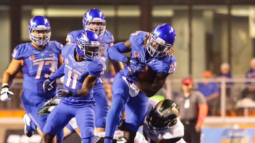 Boise State running back Jay Ajayi (27) runs the ball past Colorado State defensive back Justin Sweet, on ground, during the first half of an NCAA college football game in Boise, Idaho, on Saturday, Sept. 6, 2014. (AP Photo/Otto Kitsinger)
