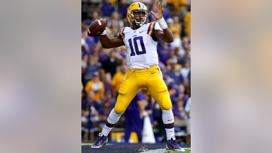 LSU quarterback Anthony Jennings (10) throws for a 94-yard touchdown during the first half of an NCAA college football game against Sam Houston State in Baton Rouge, La., Saturday, Sept. 6, 2014. (AP Photo/Jonathan Bachman)