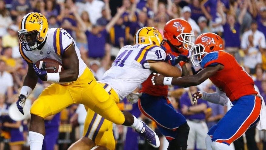 LSU running back Leonard Fournette (7) scores a touchdown on a 4-yard run during the first half of an NCAA college football game against Sam Houston State in Baton Rouge, La., Saturday, September 6, 2014. (AP Photo/Jonathan Bachman)