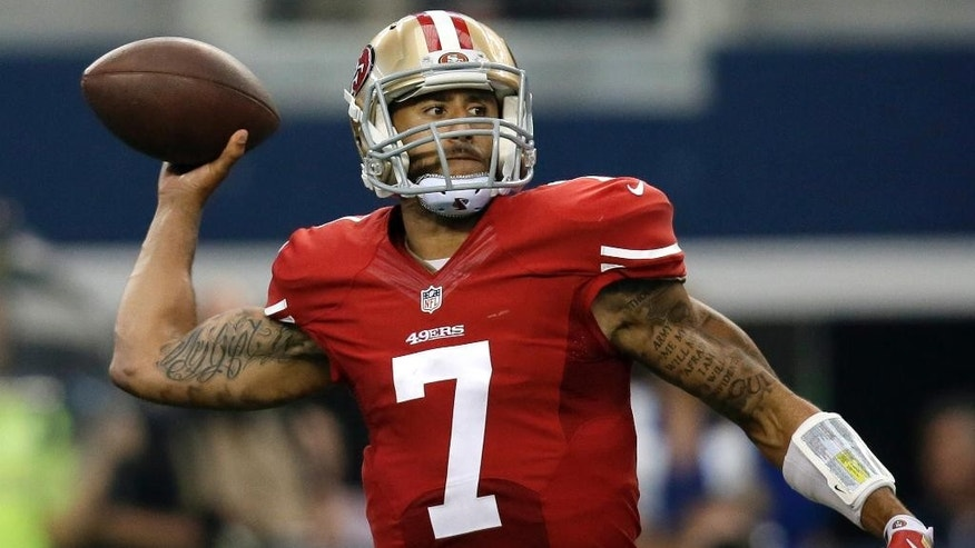 San Francisco 49ers quarterback Colin Kaepernick (7) passes against the Dallas Cowboys during the second half of an NFL football game, Sunday, Sept. 7, 2014, in Arlington, Texas. (AP Photo/Tony Gutierrez)