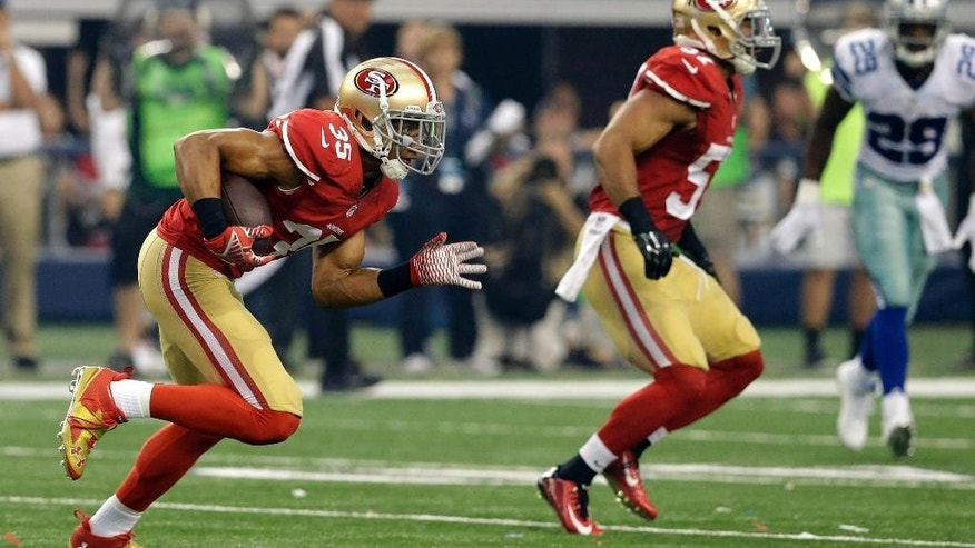 San Francisco 49ers free safety Eric Reid (35) carries the ball after recovering a fumble in the first half of an NFL football game against the Dallas Cowboys, Sunday, Sept. 7, 2014, in Arlington, Texas. (AP Photo/LM Otero)