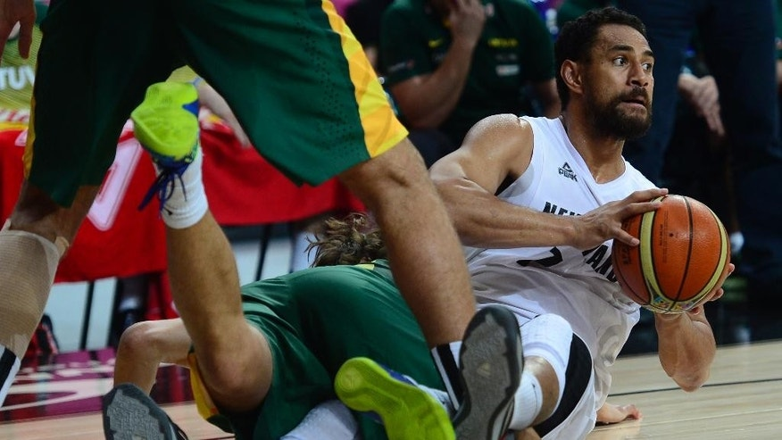 New Zealand's Mika Vukona, right, holds the ball during Basketball World Cup Round of 16 match between New Zealand and Lithuania at the Palau Sant Jordi in Barcelona, Spain, Sunday, Sept. 7, 2014. The 2014 Basketball World Cup competition will take place in various cities in Spain from Aug. 30 through to Sept. 14. (AP Photo/Manu Fernandez)
