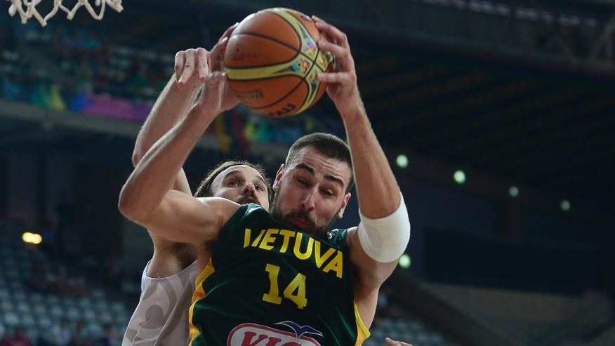 New Zealand's Casey Frank, rear, vies for the ball with Lithuania's Jonas Valanciunas during their Basketball World Cup Round of 16 match at the Palau Sant Jordi in Barcelona, Spain, Sunday, Sept. 7, 2014. The 2014 Basketball World Cup competition will take place in various cities in Spain from Aug. 30 through to Sept. 14. (AP Photo/Manu Fernandez)