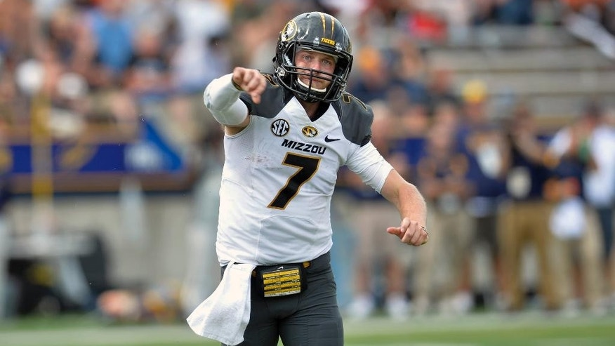 Missouri quarterback Maty Mauk (7) completes a pass for a first down in the fourth quarter of an NCAA college football game against the Toledo in Toledo, Ohio, Saturday, Sept. 6, 2014. Missouri won 49-24. (AP Photo/David Richard)