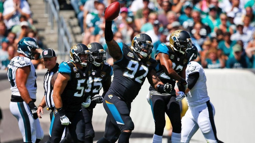Jacksonville Jaguars' Ziggy Hood celebrates after a fumble by Philadelphia Eagles' Nick Foles during the first half of an NFL football game, Sunday, Sept. 7, 2014, in Philadelphia. (AP Photo/Matt Rourke)