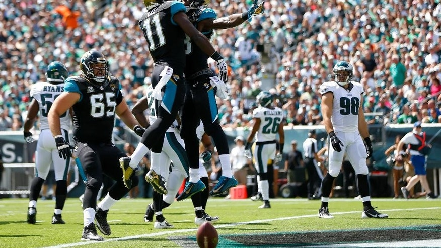 Jacksonville Jaguars' Marqise Lee (11) and Allen Hurns (88) celebrate after a touchdown by Hurns during the first half of an NFL football game against the Philadelphia Eagles, Sunday, Sept. 7, 2014, in Philadelphia. (AP Photo/Matt Rourke)
