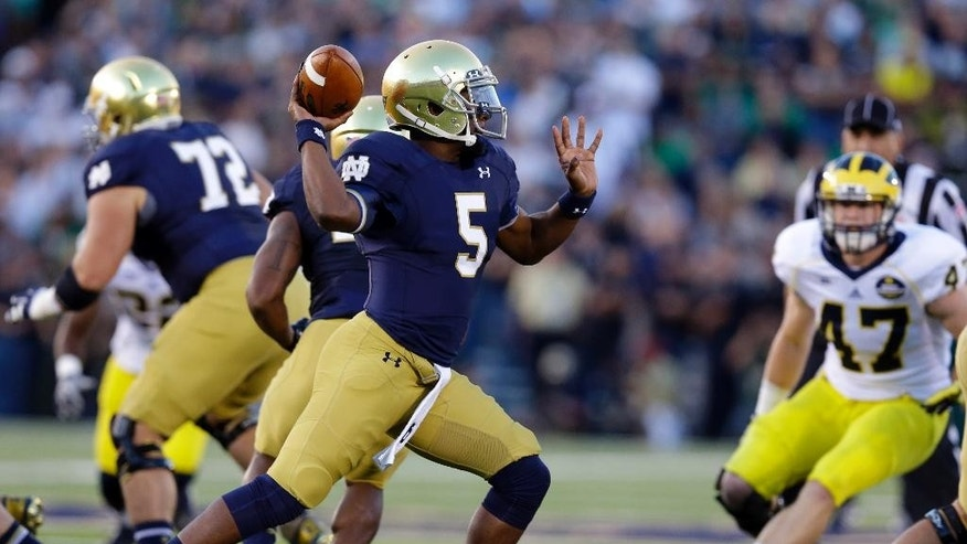 Notre Dame quarterback Everett Golson throws against Michigan during the first half of an NCAA college football game in South Bend, Ind., Saturday, Sept. 6, 2014. (AP Photo/Michael Conroy)