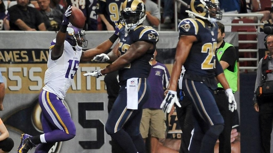 Minnesota Vikings wide receiver Greg Jennings, left, celebrates as he runs past St. Louis Rams linebacker Alec Ogletree, center, and strong safety T.J. McDonald after catching an 8-yard touchdown pass during the second quarter an NFL football game Sunday, Sept. 7, 2014, in St. Louis. (AP Photo/L.G. Patterson)