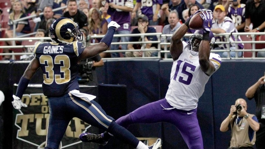 Minnesota Vikings wide receiver Greg Jennings, right, catches an 8-yard touchdown pass as St. Louis Rams cornerback E.J. Gaines defends during the second quarter an NFL football game Sunday, Sept. 7, 2014, in St. Louis. (AP Photo/Tom Gannam)