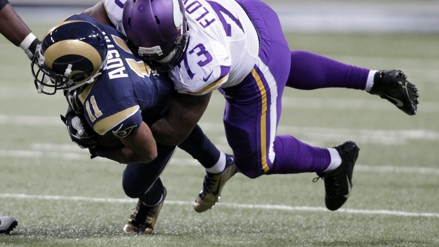 St. Louis Rams wide receiver Tavon Austin (11) is stopped for a 3-yard loss by Minnesota Vikings defensive tackle Sharrif Floyd during the second quarter an NFL football game Sunday, Sept. 7, 2014, in St. Louis. (AP Photo/Tom Gannam)