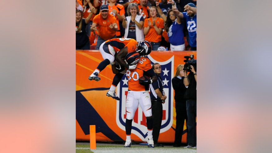 Denver Broncos tight end Julius Thomas (80) celebrates his touchdown with teammate Montee Ball (28) during the first half of an NFL football game, Sunday, Sept. 7, 2014, in Denver. (AP Photo/Jack Dempsey)