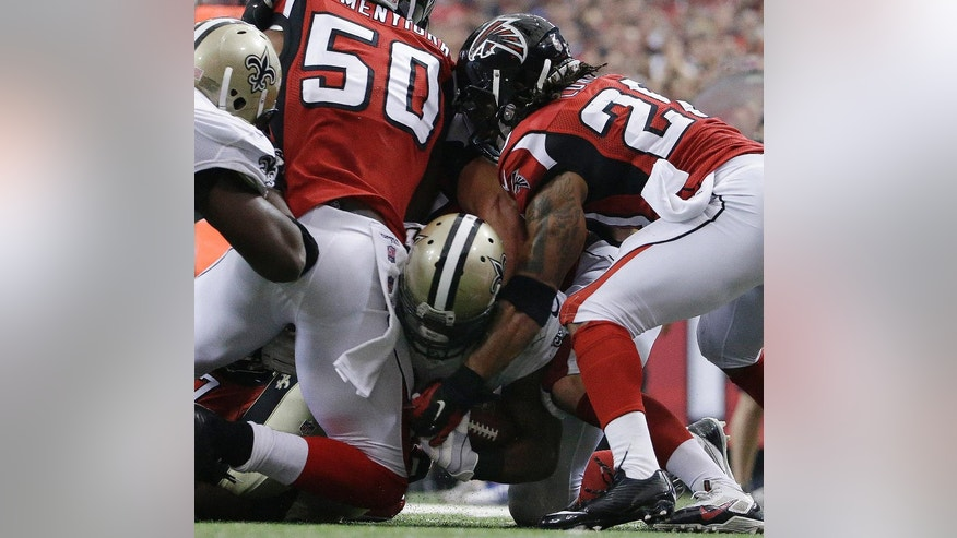 New Orleans Saints running back Mark Ingram (22) scores a touchdown against the Atlanta Falcons during the second half of an NFL football game, Sunday, Sept. 7, 2014, in Atlanta. (AP Photo/David Goldman)