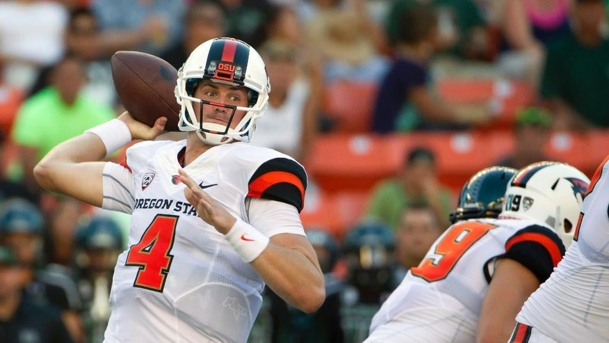 Oregon State quarterback Sean Mannion (4) throws a pass in the second quarter of an NCAA college football game, Saturday, Sept. 6, 2014, in Honolulu. (AP Photo/Eugene Tanner)