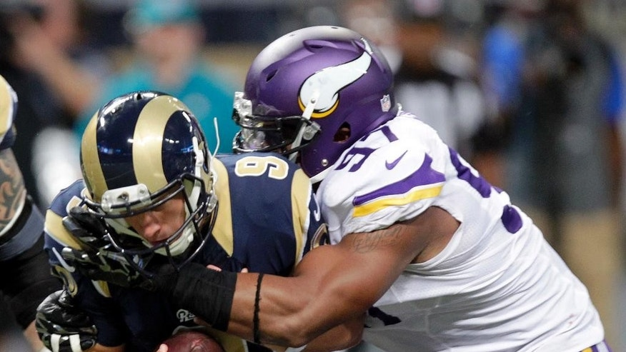 St. Louis Rams quarterback Austin Davis, left, is sacked for a 1-yard loss by Minnesota Vikings defensive end Everson Griffen during the fourth quarter an NFL football game Sunday, Sept. 7, 2014, in St. Louis. (AP Photo/Tom Gannam)