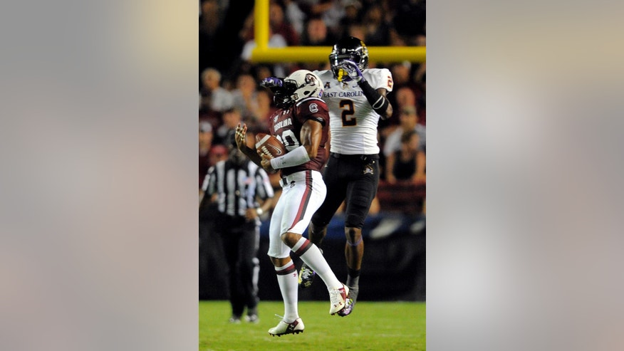 South Carolina safety T.J. Gurley (20) intercepts a pass in front East Carolina wide receiver Justin Hardy (2) of during the second half of an NCAA college football game, Saturday, Sept. 6, 2014, in Columbia, S.C. South Carolina won 33-23. (AP Photo/Stephen B. Morton)