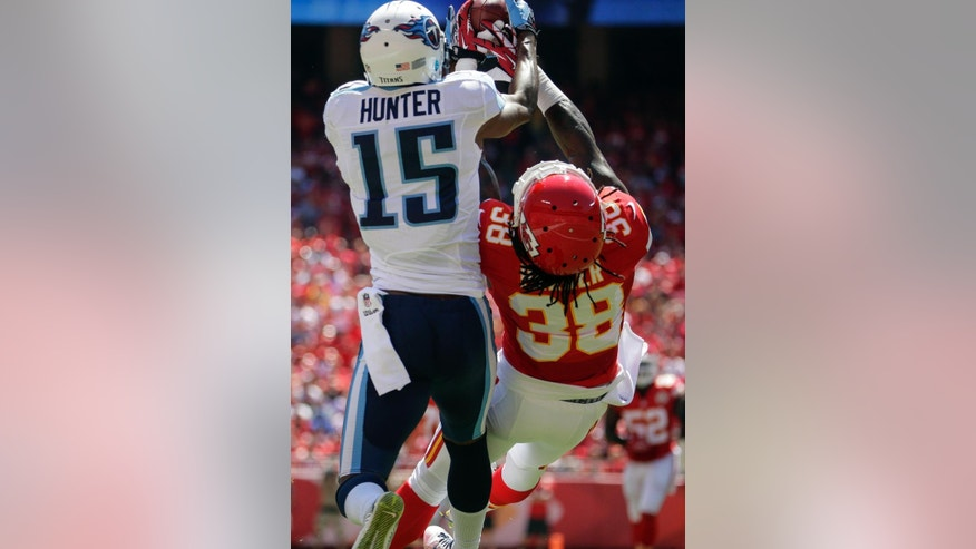 Kansas City Chiefs defensive back Ron Parker (38) breaks up a pass intended for Tennessee Titans wide receiver Justin Hunter (15) in the first half of an NFL football game in Kansas City, Mo., Sunday, Sept. 7, 2014. (AP Photo/Charlie Riedel)