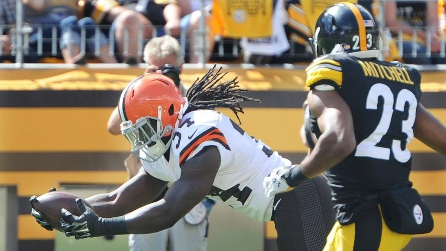 Cleveland Browns running back Isaiah Crowell (34) dives past Pittsburgh Steelers free safety Mike Mitchell (23) for a touchdown in the third quarter of the NFL football game on Sunday, Sept. 7, 2014 in Pittsburgh. (AP Photo/Don Wright)