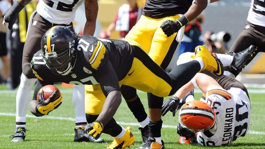 Pittsburgh Steelers running back LeGarrette Blount (27) goes over Cleveland Browns defensive back Jim Leonhard (30) for a touchdown in the first quarter of the NFL football game on Sunday, Sept. 7, 2014, in Pittsburgh. (AP Photo/Don Wright)