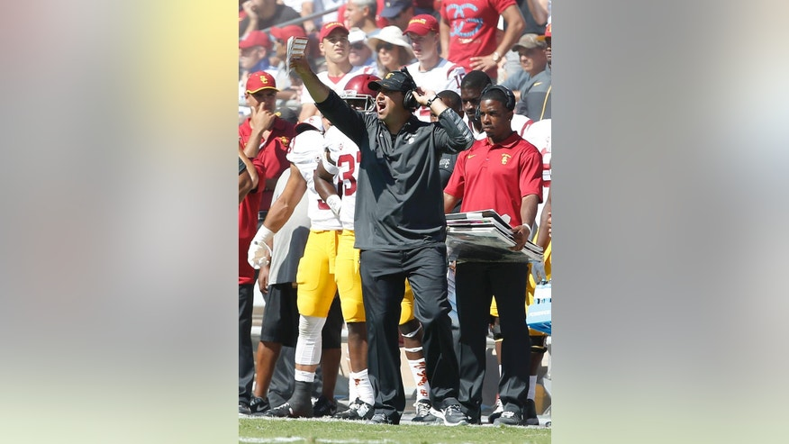 Southern California head coach Steve Sarkisian argues a referees call during the second half against Stanford in a NCAA college football game on Saturday, Sept. 6, 2014, in Stanford, Calif. Southern California won 13-10. (AP Photo/Tony Avelar)