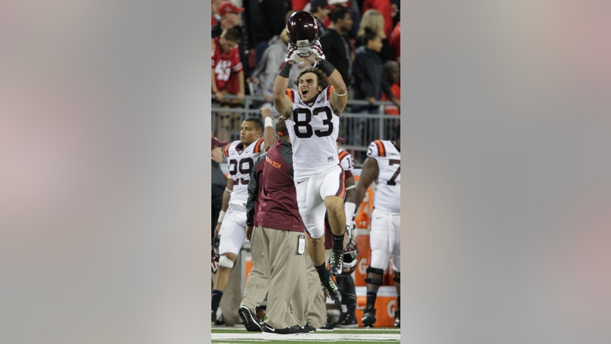 Virginia Tech wide receiver Charley Meyer celebrates their win over Ohio State in an NCAA college football game Saturday, Sept. 6, 2014, in Columbus, Ohio. Virginia Tech beat Ohio State 35-21. (AP Photo/Jay LaPrete)