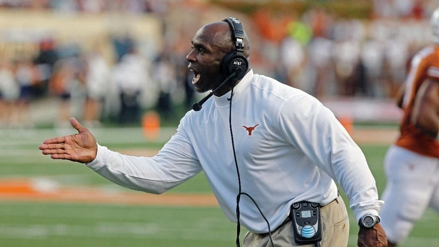 Texas head coach Charlie Strong shouts to his team during the first quarter of an NCAA college football game against BYU in Austin, Texas, Saturday,  Sept. 6, 2014.  (AP Photo/Michael Thomas)