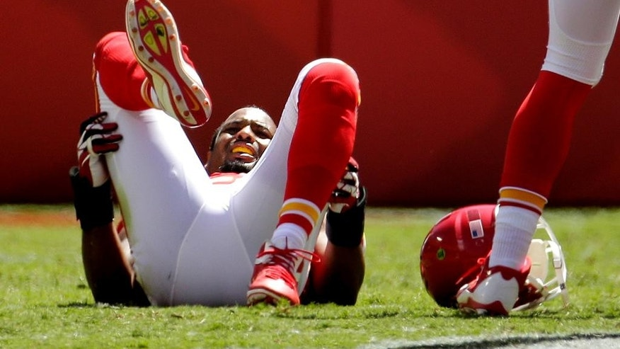 Kansas City Chiefs inside linebacker Derrick Johnson lies on the field after getting injured during the first half of an NFL football game against the Tennessee Titans in Kansas City, Mo., Sunday, Sept. 7, 2014. (AP Photo/Charlie Riedel)
