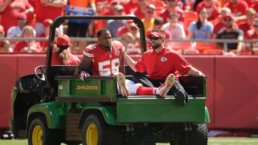 Injured Kansas City Chiefs linebacker Derrick Johnson (56) is taken off the field in the first half of an NFL football game against Tennessee Titans in Kansas City, Mo., Sunday, Sept. 7, 2014. (AP Photo/Charlie Riedel)