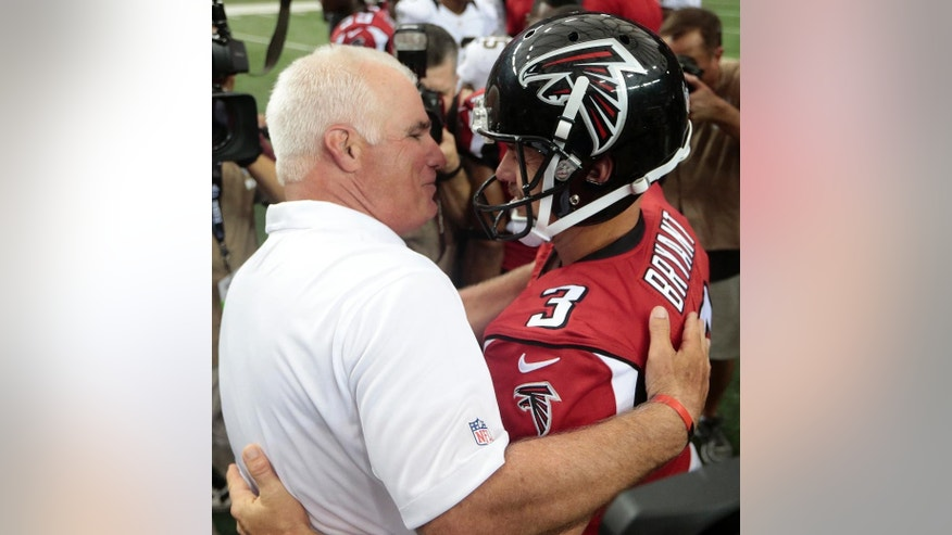 Atlanta Falcons head coach Mike Smith embraces Atlanta Falcons kicker Matt Bryant (3) after Bryant kicked the game-winning field goal against the New Orleans Saints during overtime of an NFL football game, Sunday, Sept. 7, 2014, in Atlanta. The Atlanta Falcons won in overtime 37-34. (AP Photo/John Bazemore)