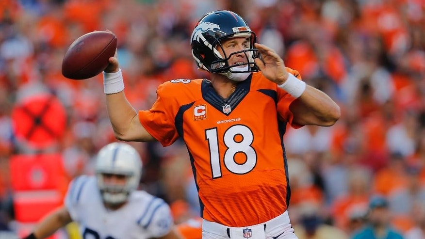 Denver Broncos quarterback Peyton Manning (18) throws against the Indianapolis Colts during the first half of an NFL football game, Sunday, Sept. 7, 2014, in Denver. (AP Photo/Joe Mahoney)