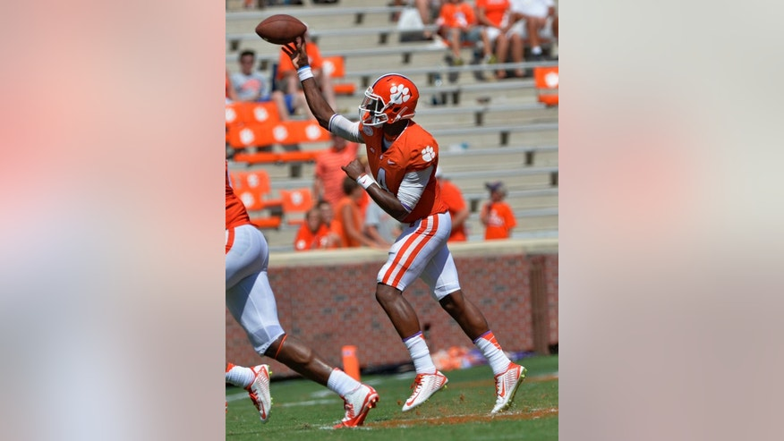 FILE - In this Sept. 6, 2014, file photo, Clemson quarterback Dashaun Watson throws a pass during an NCAA college football game against South Carolina State in Clemson, S.C. Fans believe freshman backup Watson is No. 23 Clemson's best chance at defeating No. 1 Florida State in two weeks. (AP Photo/ Richard Shiro, File)