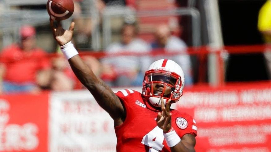 Nebraska quarterback Tommy Armstrong Jr. (4) throws in the first half of an NCAA college football game against McNeese State in Lincoln, Neb., Saturday, Sept. 6, 2014. (AP Photo/Nati Harnik)