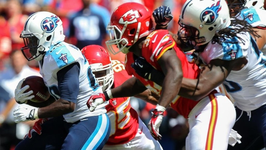 Tennessee Titans running back Leon Washington (29) is tackled by Kansas City Chiefs defensive tackle Vance Walker (99) in the first half of an NFL football game in Kansas City, Mo., Sunday, Sept. 7, 2014. (AP Photo/Ed Zurga)