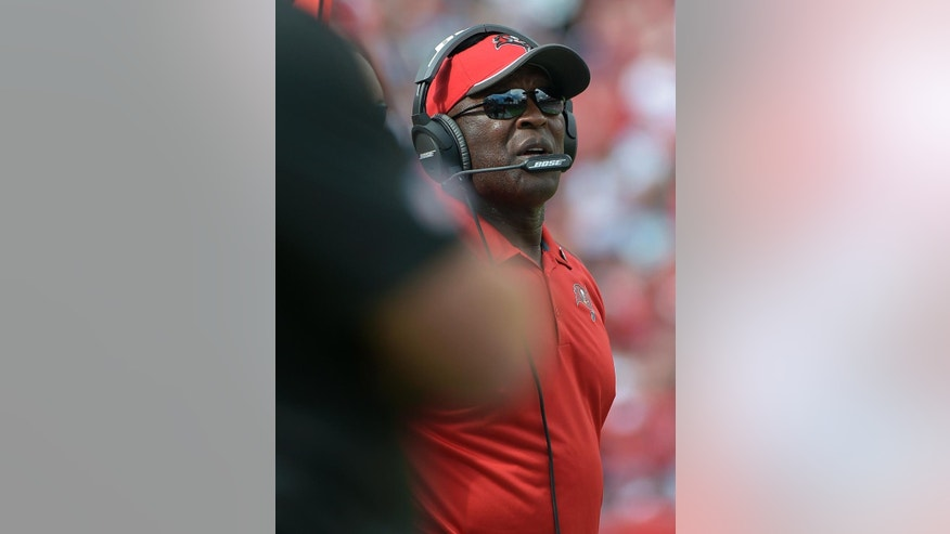 New Tampa Bay Buccaneers head coach Lovie Smith looks on during the second quarter of an NFL football game against the Carolina Panthers, Sunday, Sept. 7, 2014, in Tampa, Fla. (AP Photo/Phelan M. Ebenhack)